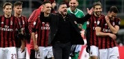 AC Milan's coach from Italy Gennaro Gattuso (black suit) celebrate with his players after winning the Italian Serie A football match between AC Milan and Sampdoria at the San Siro stadium in Milan on February 18, 2018. / AFP PHOTO / MIGUEL MEDINA        (Photo credit should read MIGUEL MEDINA/AFP/Getty Images)