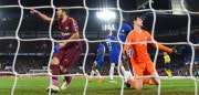 LONDON, ENGLAND - FEBRUARY 20:  Luis Suarez of Barcelona celebrates after Lionel Messi (Not pictured) of Barcelona scores his sides first goal, as Thibaut Courtois of Chelsea looks dejected during the UEFA Champions League Round of 16 First Leg  match between Chelsea FC and FC Barcelona at Stamford Bridge on February 20, 2018 in London, United Kingdom.  (Photo by Mike Hewitt/Getty Images)