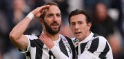 TOPSHOT - Juventus' Argentinian forward Gonzalo Higuain (L) celebrates with his teammate Juventus' Italian midfielder Federico Bernardeschi (R) after scoring a goal during the Italian Serie A football match between Juventus and Sassuolo on February 4, 2018 at the 'Allianz Stadium' in Turin.  / AFP PHOTO / MARCO BERTORELLO        (Photo credit should read MARCO BERTORELLO/AFP/Getty Images)