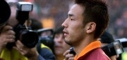 ROME, ITALY:  AS Roma's midfielder Japanese Hidetoshi Nakata is surrounded by photographers, before the first Italian league match AS Roma vs Verona, 16 January 2000, at the Olympic Stadium in Rome. AS Roma beat Verona 3 goals to 1.  (ELECTRONIC IMAGE) Le milieu de terrain de l'AS Roma, le japonais Hidetoshi Nakata est entourT de photographes, avant le match opposant Rome a VTrone, le 16 janvier 2000 a Rome, comptant pour la 17F journTe du Championnat d'Italie de premiFre division. (Photo credit should read GABRIEL BOUYS/AFP/Getty Images)