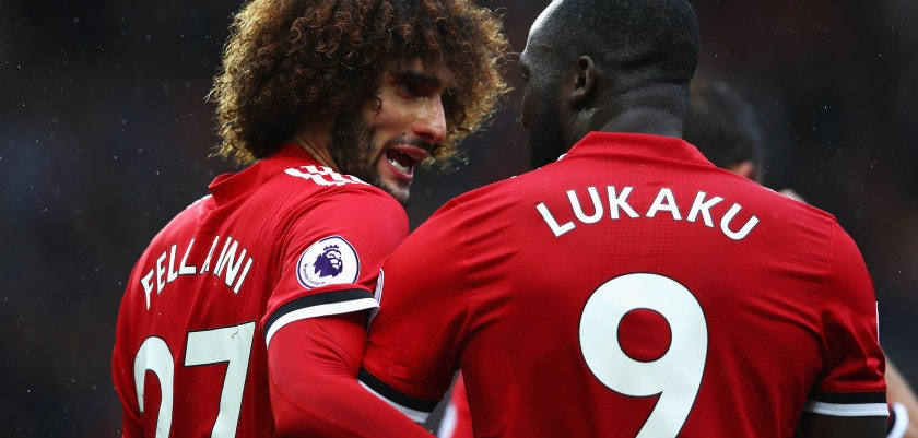 MANCHESTER, ENGLAND - SEPTEMBER 30:  Romelu Lukaku (R) of Manchester United celebrates scoring his side's fourth goal with his team mate Marouane Fellaini (L) during the Premier League match between Manchester United and Crystal Palace at Old Trafford on September 30, 2017 in Manchester, England.  (Photo by Clive Brunskill/Getty Images)
