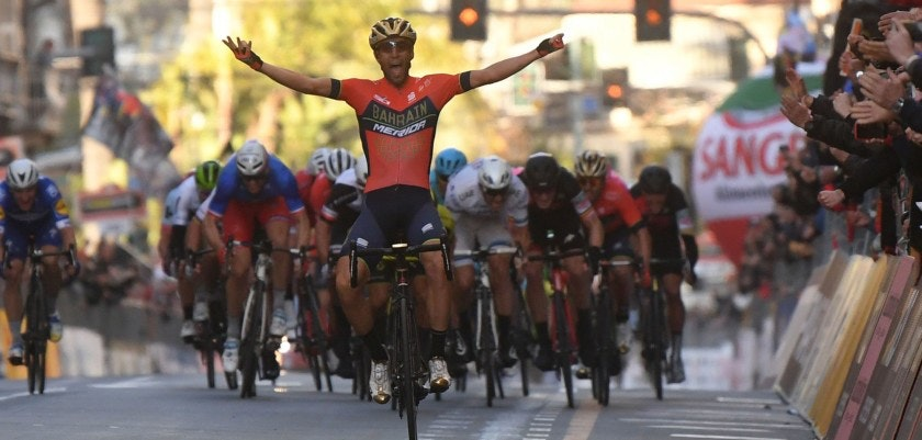 Italy's Vincenzo Nibali (C) of team Bahrain celebrates as he crosses the finish line to win the 109th edition of the Milan - San Remo cycling race on March 17, 2018.  The 2014 Tour de France winner, nicknamed 'The Shark', cut through the sprint favourites after the 294km race to snatch victory ahead of Australian Caleb Ewan and France's Arnaud Demare. / AFP PHOTO / Marco BERTORELLO        (Photo credit should read MARCO BERTORELLO/AFP/Getty Images)