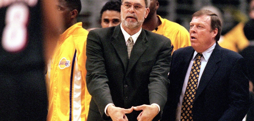 LOS ANGELES - JUNE 4:  Head coach Phil Jackson of the Los Angeles Lakers signals triangle defense as assistant coach Frank Hamblen looks on during Game 7 of the Western Conference Finals against the Portland Trail Blazers at Staples Center on June 4, 2000 in Los Angeles, California. The Lakers won 98-94. NOTE TO USER: User expressly acknowledges and agrees that, by downloading and/or using this Photograph, user is consenting to the terms and conditions of the Getty Images License Agreement. (Photo by Tom Hauck/Getty Images)