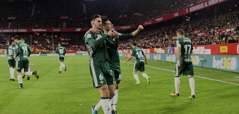 Real Betis' Spanish midfielder Fabian Ruiz (C-L) celebrates with teammates after scoring a goal during the Spanish league football match between Sevilla and Real Betis at the Sanchez Pizjuan stadium in Sevilla on January 6, 2018. / AFP PHOTO / CRISTINA QUICLER        (Photo credit should read CRISTINA QUICLER/AFP/Getty Images)