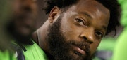 GLENDALE, AZ - NOVEMBER 09:  Defensive end Michael Bennett #72 of the Seattle Seahawks on the bench during the first half of the NFL game against the Arizona Cardinals at the University of Phoenix Stadium on November 9, 2017 in Glendale, Arizona.  (Photo by Christian Petersen/Getty Images)