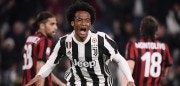 Juventus' midfielder Juan Cuadrado from Colombia celebrates after scoring during the Italian Serie A football match Juventus Vs AC Milan on March 31, 2018 at the 'Allianz Stadium' in Turin. / AFP PHOTO / MARCO BERTORELLO        (Photo credit should read MARCO BERTORELLO/AFP/Getty Images)