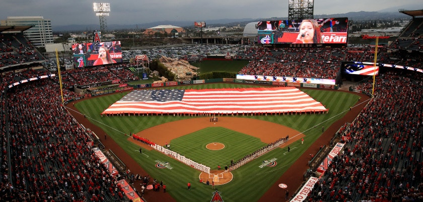 ANAHEIM, CA - APRIL 02:  A large American flag is unfurled during introductions of the Los Angeles Angels of Anaheim and the Cleveland Indians prior to the Los Angeles Angels of Anaheim  home opening game at Angel Stadium on April 2, 2018 in Anaheim, California.  (Photo by Sean M. Haffey/Getty Images)