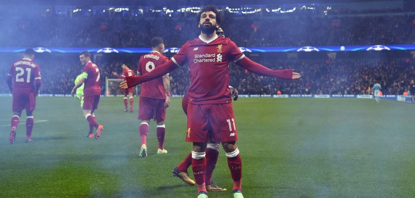 Liverpool's Egyptian midfielder Mohamed Salah celebrates scoring his team's first goal during the UEFA Champions League second leg quarter-final football match between Manchester City and Liverpool, at the Etihad Stadium in Manchester, north west England on April 10, 2018. / AFP PHOTO / Paul ELLIS        (Photo credit should read PAUL ELLIS/AFP/Getty Images)