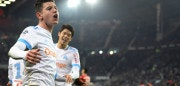 Olympique de Marseille's French midfielder Florian Thauvin (L) celebrates after scoring a goal during the French L1 football match Rennes vs Marseille on January 13, 2018 at the Roazhon park stadium in Rennes, western France. / AFP PHOTO / DAMIEN MEYER        (Photo credit should read DAMIEN MEYER/AFP/Getty Images)