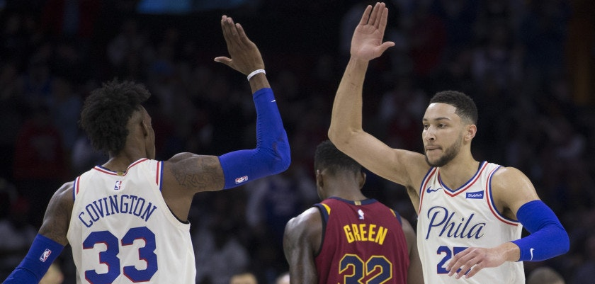 PHILADELPHIA, PA - APRIL 6: Robert Covington #33 and Ben Simmons #25 of the Philadelphia 76ers celebrate in front of Jeff Green #32 of the Cleveland Cavaliers during a timeout in the first quarter at the Wells Fargo Center on April 6, 2018 in Philadelphia, Pennsylvania. NOTE TO USER: User expressly acknowledges and agrees that, by downloading and or using this photograph, User is consenting to the terms and conditions of the Getty Images License Agreement. (Photo by Mitchell Leff/Getty Images)