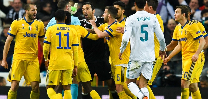 MADRID, SPAIN - APRIL 11: Gianluigi Buffon of Juventus argues with the referee Michael Oliver during the UEFA Champions League Quarter Final scond leg match between Real Madrid and Juventus at Estadio Santiago Bernabeu on April 11, 2018 in Madrid, Spain.  (Photo by David Ramos/Getty Images)