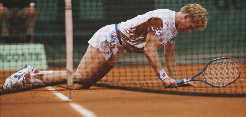 Boris Becker of Germany picks himself up from the clay court surface during a Men's Singles match at the French Open Tennis Championship on 29 May 1988 at the Stade Roland Garros Stadium in Paris, France. (Photo by Simon Bruty/Getty Images)