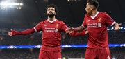 MANCHESTER, ENGLAND - APRIL 10:  Mohamed Salah of Liverpool celebrates scoring the first goal with Roberto Firmino during the Quarter Final Second Leg match between Manchester City and Liverpool at Etihad Stadium on April 10, 2018 in Manchester, England.  (Photo by Laurence Griffiths/Getty Images,)