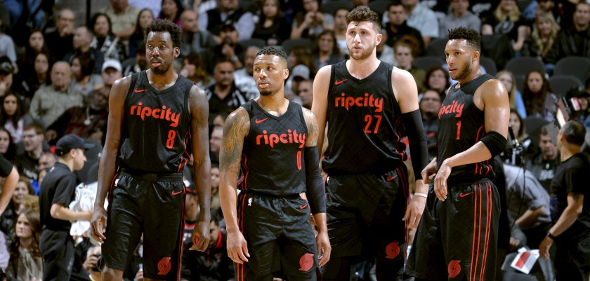 SAN ANTONIO, TX - APRIL 7:  Al-Farouq Aminu #8, Damian Lillard #0, Jusuf Nurkic #27, and Evan Turner #1 of the Portland Trail Blazers look on during the game against the San Antonio Spurs  on April 7, 2018 at the AT&T Center in San Antonio, Texas. NOTE TO USER: User expressly acknowledges and agrees that, by downloading and or using this photograph, user is consenting to the terms and conditions of the Getty Images License Agreement. Mandatory Copyright Notice: Copyright 2018 NBAE (Photos by Mark Sobhani/NBAE via Getty Images)