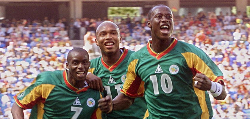 SUWON, REPUBLIC OF KOREA:  Senegalese defender Khalilou Fadiga (R) celebrates his goal from a penalty kick with teammates Henri Camara (L-#7) and El Hadj Diouf (C) in their Group A match against Uruguay at the 2002 FIFA World Cup Korea/Japan in Suwon, 11 June 2002.  Senegal were leading 2-0 as play continues in the first half.     AFP PHOTO/Jimin LAI (Photo credit should read JIMIN LAI/AFP/Getty Images)