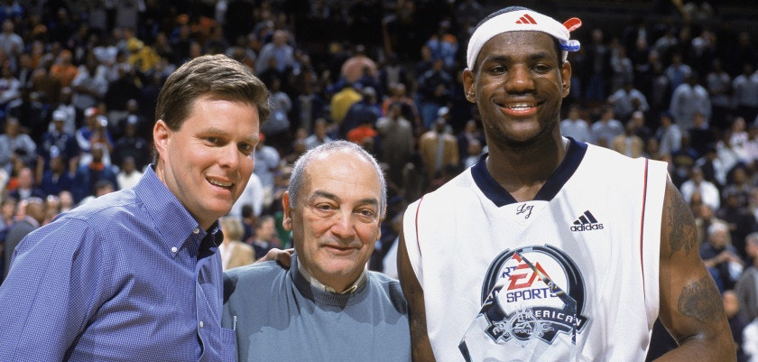 CHICAGO - MARCH 31:  LeBron James #23 of Team West stands alongside Roundball Chairman Sonny Vaccaro during the EA Sports Roundball Classic game against Team East at United Center on March 31, 2003 in Chicago, Illinois. Team West won 120-119.  NOTE TO USER: User expressly acknowledges and agrees that, by downloading and/or using this Photograph, User is consenting to the terms and conditions of the Getty Images License Agreement. Mandatory copyright notice:  Copyright 2003 NBAE (Photo by Garrett Ellwood/NBAE via Getty Images)