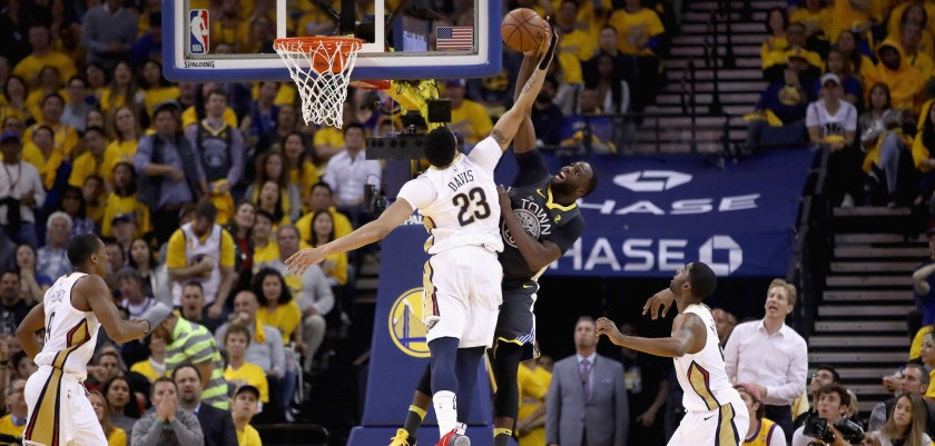 OAKLAND, CA - MAY 01:  Anthony Davis #23 of the New Orleans Pelicans goes up for a shot on Draymond Green #23 of the Golden State Warriors during Game Two of the Western Conference Semifinals during the 2018 NBA Playoffs at ORACLE Arena on May 1, 2018 in Oakland, California.  NOTE TO USER: User expressly acknowledges and agrees that, by downloading and or using this photograph, User is consenting to the terms and conditions of the Getty Images License Agreement.  (Photo by Ezra Shaw/Getty Images)