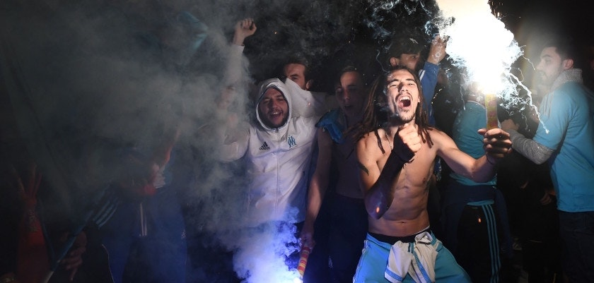 Olympique de Marseille (OM) fans react after victory of their team in the Europa League semi-final football match Salzburg against Marseille in Marseille on May 3, 2018. (Photo by Anne-Christine POUJOULAT / AFP)        (Photo credit should read ANNE-CHRISTINE POUJOULAT/AFP/Getty Images)