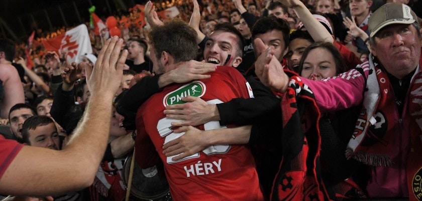 TOPSHOT - Les Herbier's footballer Franck Héry (C) celebrates with supporters after winning the French cup semi-final match between Les Herbiers and Chambly at The Beaujoire Stadium in Nantes on April 17, 2018. / AFP PHOTO / LOIC VENANCE        (Photo credit should read LOIC VENANCE/AFP/Getty Images)