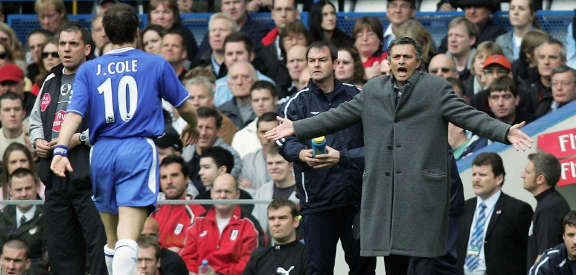 LONDON - APRIL 23:  Joe Cole of Chelsea walks over to the bench to listen to Manager, Jose Mourihno after scoring the first goal of the game during the Barclays Premiership match between Chelsea and Fulham at Stamford Bridge on April 23, 2005 in London, England.  (Photo by Ben Radford/Getty Images) *** Local Caption *** Joe Cole;Jose Mourihno
