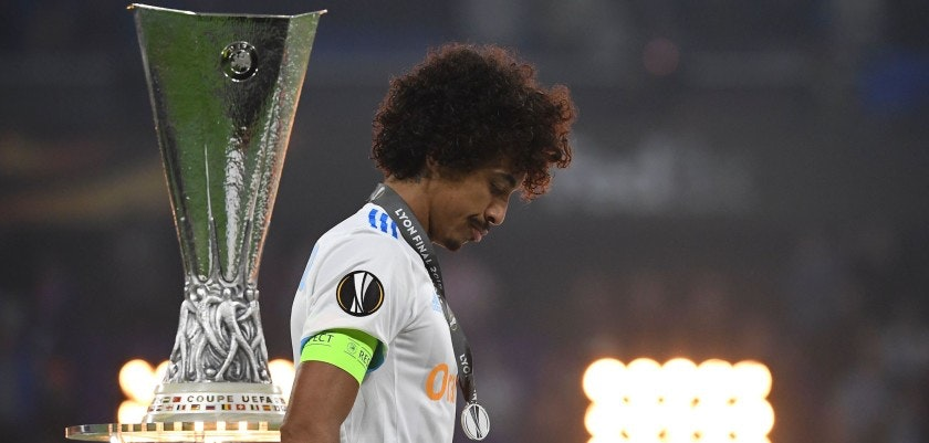 Marseille's Brazilian midfielder Luiz Gustavo walks past the trophy after the UEFA Europa League final football match between Olympique de Marseille and Club Atletico de Madrid at the Parc OL stadium in Decines-Charpieu, near Lyon on May 16, 2018. (Photo by FRANCK FIFE / AFP)        (Photo credit should read FRANCK FIFE/AFP/Getty Images)