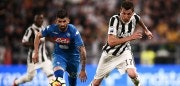 Napoli's Albanian defender Elseid Hysaj (L) fights for the ball with Juventus' Croatian forward Mario Mandzukic (R) during the Italian Serie A football match between Juventus and Napoli on April 22, 2018 at the Allianz Stadium in Turin. (Photo by MARCO BERTORELLO / AFP)        (Photo credit should read MARCO BERTORELLO/AFP/Getty Images)