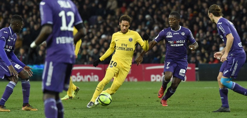 Paris Saint-Germain's Brazilian forward Neymar Jr (C) outruns Toulouse's Ivorian forward Max-Alain Gradel (2ndR) during the French L1 football match between Toulouse (TFC) and Paris Saint-Germain (PSG) on February 10, 2018 at the Municipal stadium in Toulouse.  / AFP PHOTO / PASCAL PAVANI        (Photo credit should read PASCAL PAVANI/AFP/Getty Images)