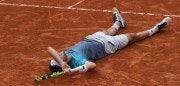 TOPSHOT - Italy's Marco Cecchinato celebrates after victory over Serbia's Novak Djokovic during their men's singles quarter-final match on day ten of The Roland Garros 2018 French Open tennis tournament in Paris on June 5, 2018. (Photo by CHRISTOPHE ARCHAMBAULT / AFP)        (Photo credit should read CHRISTOPHE ARCHAMBAULT/AFP/Getty Images)