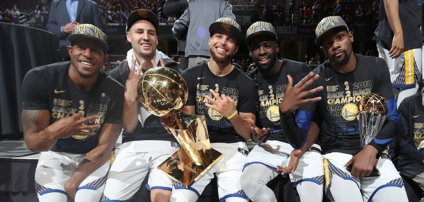 CLEVELAND, OH - JUNE 8: Andre Iguodala #9, Klay Thompson #11, Stephen Curry #30, Draymond Green #23, and Kevin Durant #35 of the Golden State Warriors pose with the Larry O'Brien Championship Trophy after Game Four of the 2018 NBA Finals against the Cleveland Cavaliers on June 8, 2018 at Quicken Loans Arena in Cleveland, Ohio. NOTE TO USER: User expressly acknowledges and agrees that, by downloading and/or using this photograph, user is consenting to the terms and conditions of the Getty Images License Agreement. Mandatory Copyright Notice: Copyright 2018 NBAE (Photo by Nathaniel S. Butler/NBAE via Getty Images)