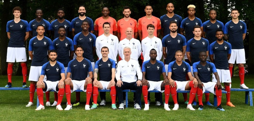 TOPSHOT - France's national football team (3rd row, from L): France's defender Benjamin Pavard, France's defender Benjamin Mendy, France's defender Samuel Umtiti, France's defender Adil Rami, France's goalkeeper Steve Mandanda, France's goalkeaper Hugo Lloris, France's goalkeeper Alphonse Aerola, France's midfielder Steven N'zonzi, France's defender Presnel Kimpembe, France's defender Djibril Sidibé and France's defender Lucas Hernandez, (2nd row, from L) France's midfielder Corentin Tolisso, France's forward Ousmane Dembele, France's midfielder Paul Pogba, goalkeeper coach Franck Raviot, assistant coach Guy Stephan, physical trainer Gregory Dupont, France's forward Olivier Giroud, France's forward Florian Thauvin, France's midfielder Thomas Lemar, (front row, from L) France's forward Nabil Fekir, France's defender Raphael Varane, France's forward Antoine Griezmann, France's head coach Didier Deschamps, France's midfielder Blaise Matuidi, France's forward Kylian Mbappe and France's midfielder N'Golo Kante pose on May 30, 2018 in Clairefontaine-en-Yvelines ahead of the upcoming FIFA World Cup 2018 in Russia. (Photo by FRANCK FIFE / AFP)        (Photo credit should read FRANCK FIFE/AFP/Getty Images)