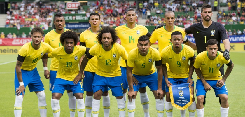Brazil's team (back row, L to R) Brazil's midfielder Paulinho, Brazil's defender Thiago Silva, Brazil's defender Danilo, Brazil's defender Joao Miranda and Brazil's goalkeeper Alisson Ramses Becker, (front row, L to R) Brazil's forward Neymar, Brazil's midfielder Willian, Brazil's defender Marcelo, Brazil's midfielder Casemiro, Brazil's forward Gabriel Jesus and Brazil's midfielder Philippe Coutinho Correia pose for a team photo ahead the international friendly footbal match Austria vs Brazil in Vienna, on June 10, 2018. (Photo by VLADIMIR SIMICEK / AFP)        (Photo credit should read VLADIMIR SIMICEK/AFP/Getty Images)