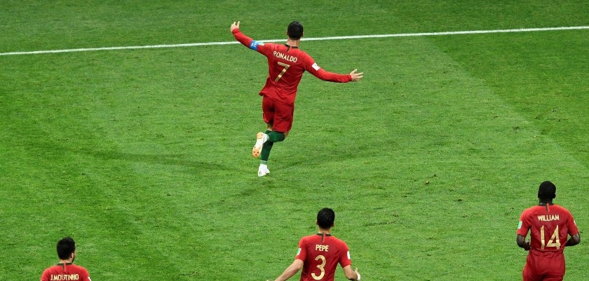 Portugal's forward Cristiano Ronaldo (7) celebrates after scoring his third goal during the Russia 2018 World Cup Group B football match between Portugal and Spain at the Fisht Stadium in Sochi on June 15, 2018. (Photo by Jonathan NACKSTRAND / AFP) / RESTRICTED TO EDITORIAL USE - NO MOBILE PUSH ALERTS/DOWNLOADS        (Photo credit should read JONATHAN NACKSTRAND/AFP/Getty Images)