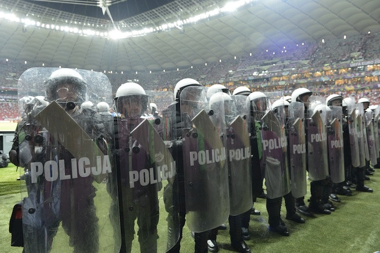 Riot policemen stand guard during  the E