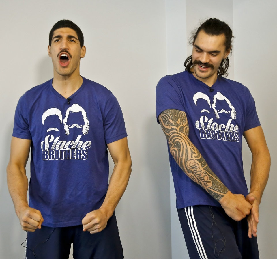 Oklahoma City Thunder players Enes Kanter and Steven Adams pose for photos as they talk about being the 'Stache Brothers' at the Oklahoma City Thunder practice facility in Oklahoma City, Okla. on Friday, April 1, 2016. Photo by Chris Landsberger, The Oklahoman