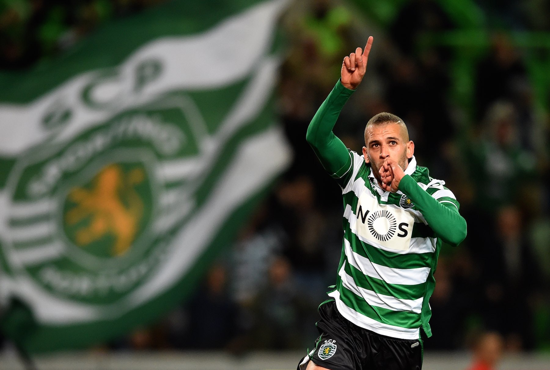 Sporting's Algerian forward Islam Slimani celebrates after scoring the opening goal during the Portuguese League football match Sporting CP vs FC Porto at Alvalade stadium in Lisbon on January 2, 2016. AFP PHOTO/ FRANCISCO LEONG / AFP / FRANCISCO LEONG (Photo credit should read FRANCISCO LEONG/AFP/Getty Images)