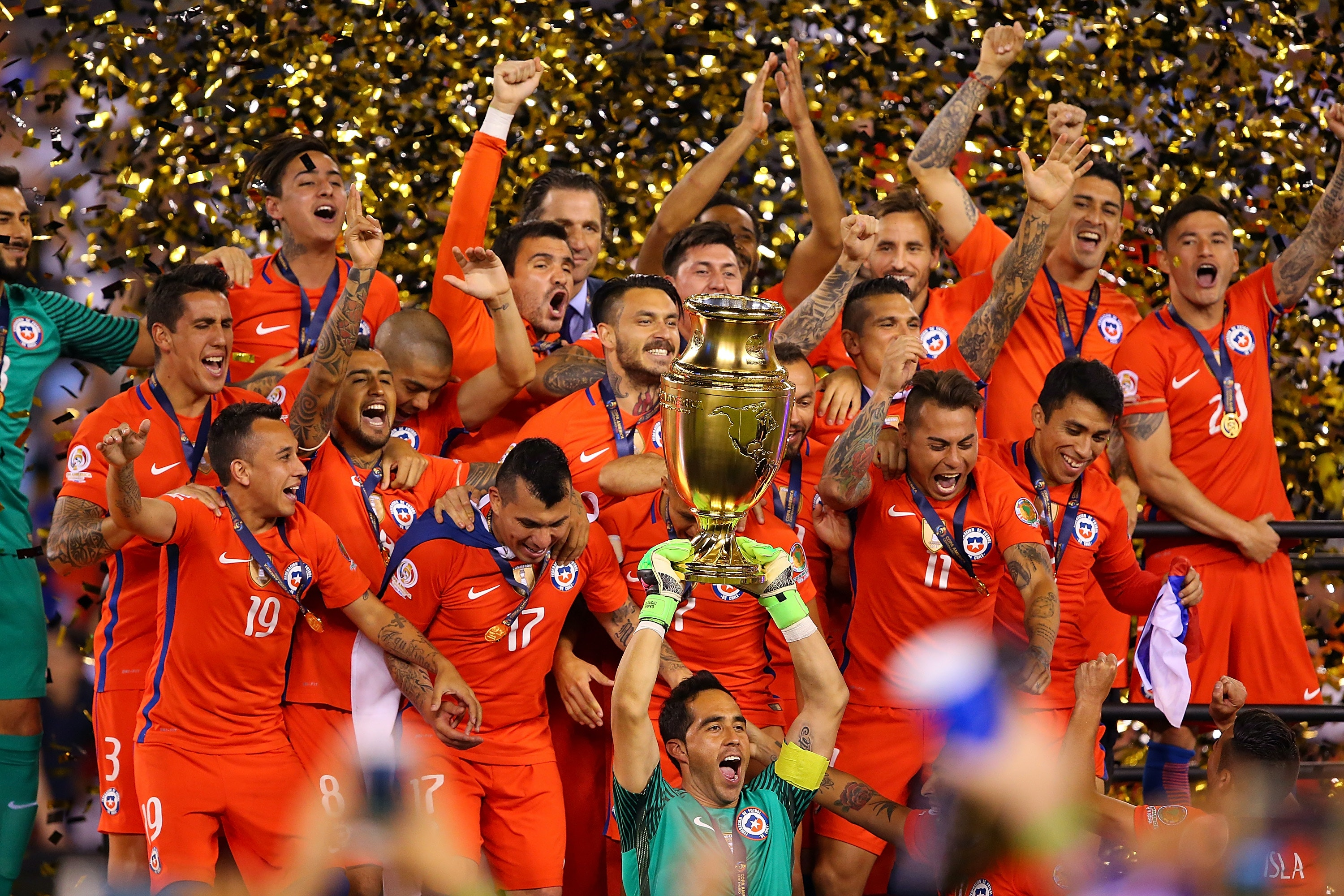 EAST RUTHERFORD, NJ - JUNE 26: Claudio Bravo #1 of Chile hoist the trophy after defeating Argentina to win the Copa America Centenario Championship match at MetLife Stadium on June 26, 2016 in East Rutherford, New Jersey. Chile defeated Argentina 4-2 in penalty kicks. (Photo by Mike Stobe/Getty Images)