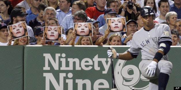 ** FILE ** In this July 25, 2008 file photo, spectators hold up photos of Madonna as New York Yankees' Alex Rodriguez waits in the on-deck circle during the eighth inning of a baseball game against the Boston Red Sox at Fenway Park in Boston. (AP Photo/Elise Amendola)